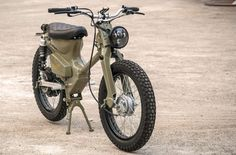 The eCub 2 is a retro electric motorcycle from the international team at Shanghai Customs, it combines the much loved Honda Super Cub chassis with an . Bobber Custom, Custom Motorcycles, Custom Bikes, Honda Cub, Retro Motorcycle, Motorcycle Bike, Electric Moped, Electric Cars, Honda Motorbikes