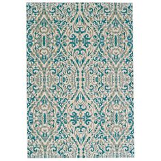 Keep high-traffic areas like your entryway or mudroom looking chic with this versatile rug, showcasing a damask motif in shades of blue.