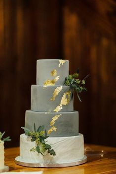 | gray wedding cake | metallic wedding cake | unique wedding cake | different wedding cake | modern wedding cake | gold wedding cake | photo taken at THE SPRINGS Event Venue. follow this pin to our website for more information, or to book your free tour! SPRINGS location: Norman, OK photographer: Christina Rose Photography #weddingcake #modernwedding #metallicweddingcake #goldweddingcake #grayweddingcake #greywedding #modernweddingcake #weddingcakeideas #uniqueweddingideas #weddingdetails