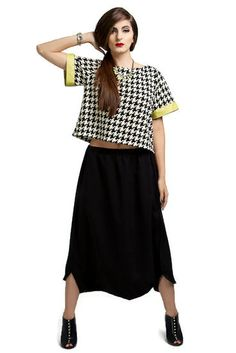 Care-free skirt-like pants that is extremely versatile for casual wear or as part of work attire. A unique twist to the usual harem pants.