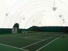 This one-court residential tennis court lies in New Albany, OH and features translucent fabric to provide natural light and save on energy bills.  This dome is installed seasonally to provide an indoor space during the winter months.
