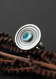 Galaxy Ring - Sterling silver ring with swiss blue topaz. by LucieVeilleux, via Etsy.