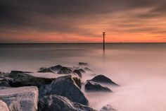 After two weekends of rain the weather conditions improved yesterday so I arranged to meet up with my Flickr friend Paul (www.flickr.com/photos/visible-landscape/) at Sandy Point, Hayling Island to capture the sunset. When we arrived there was a cold north wind blowing so we both decided to have a go at some long exposures at one of the rocky groynes at this location but just after I took this image the wind caught my tripod and camera and blew it over into the sand hitting the end the…