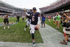 Chicago Bears quarterback Jay Cutler runs off the field after the Bears' win over the Cincinnati Bengals in an NFL football game, Sunday, Sept. in Chicago. (AP Photo/Nam Y. Nfl Football Games, Bears Football, Football Photos, Jay Cutler, Soldier Field, World Of Sports, Cincinnati Bengals, Chicago Bears, Espn