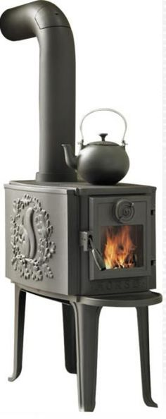 Beautiful Morso stove. Love the squirrel on the side.