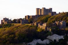 Dover Castle at Sunset from the Prince of Wales Pier, Kent, England, UK. Zoom photo of 1450 yards to edge of White Cliffs of Dover, 1850 yards to Constable's Gateway (far left). View of Keep (Great Tower), Inner Curtain Wall (Palace Gate), Outer Curtain Wall (Peverell's Gateway), and Victorian Regimental Institute (Naafi Restaurant: far right). Listed Building, English Heritage, and Scheduled Ancient Monument. History, Travel, Tourism, and Vacation. See: http://www.panoramio.com/photo/86071275