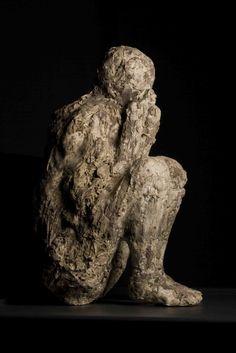 Pompeii / Italy - Body cast of crouching man ...