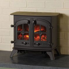 Hand painted log effect electric stove Single or double doors Removeable Tudor Rose door crosses Remote control 2kw fan heater Manufactured by Yeoman Stoves Shown: Dartmoor log effect electric stove
