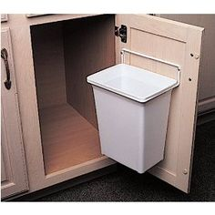 Garbage cans attached on the cabinet door. I don't have to put it under the sink which I feel my hand would be contaminated every time I have to pull it out or even the kind of bin on the drawer which I usually need to pull it out using my toe! This might be a solution for us!