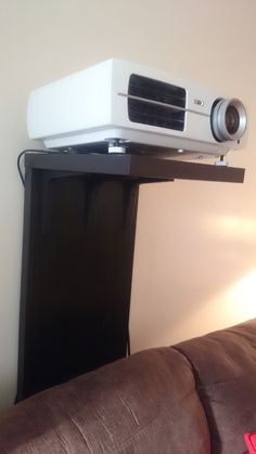 projector screen ideas home theaters A video projector stand that wont screw up your wall Projector Screen Stand, Projector Shelf, Projector In Bedroom, Projector Mount, Best Projector, Movie Projector, Projector Ideas, Home Cinema Room, Home Theater Setup