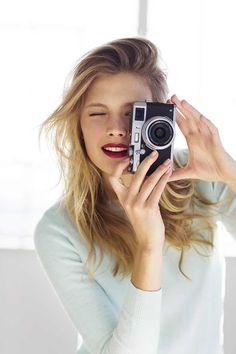 Constance Jablonski, Estee Lauder Pure Color Envy lipstick, light blue sweater, camera / Garance Doré