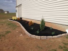 Low maintenance landscape design & installation for side areas by Ryan's Landscaping in New Oxford, Pa.