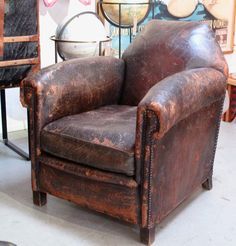 I love a worn in leather chair!! http://www.secondshoutout.com/blog/blog-categories/chairs - leg idea