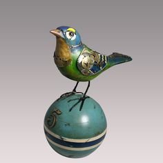 I really must have this guy. (MullaniumByJimAndTori.com) BD86-Blue Green Mechanical Bird on Croquet Ball-5 3/4 in L X 7 in H