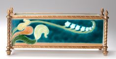 CARL LUBER Art Nouveau majolica window box jardiniere, decorated with a vanilla orchid spray, set in a metal frame, ceramic manufactured by Johann von Schwarz Nürnberg, c. 1900, 31.5cm long.  |  SOLD $2,250 Germany 2003