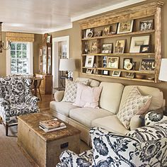 94 Living Room Decorating Ideas | Look for Inspiration in Unexpected Places | This homeowner found inspiration for her walls in a bag of gourmet marshmallows: She used the soft, sophisticated colors to dictate her palette. The plate rack that once showcased antique plates in her parents' home holds cherished photos.