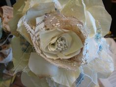 Cute idea to add lace and tulle into the flower spiral