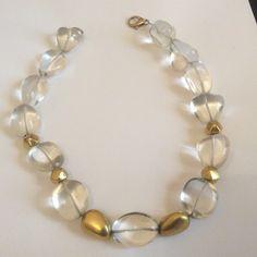 Rock crystal tumbles, gold tumbles by Elisabetta di Marino