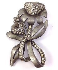 http://www.ebay.com/itm/Vintage-Silver-Tone-Pewter-Flower-Tulip-Rhinestone-Bouquet-Pin-Brooch-/141601734796?pt=LH_DefaultDomain_0&hash=item20f81f008c