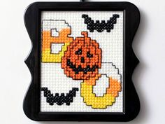 Earlier this week, we launched our free printable pumpkin stencils, and we're continuing the spooky theme of the week with our free Halloween inspired cross stitch pattern from our Bucilla team!
