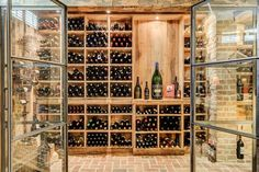 """When someone asks if you're an optimist, just show them a picture of this wine cellar and say, """"My glass is always half full of wine."""""""