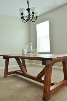 DIY farmhouse table inspired by Restoration Hardware. Created with easy-to-follow Ana White plans.