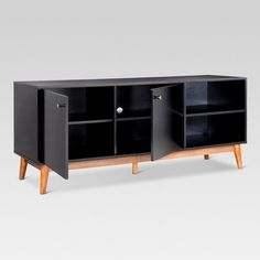 The Mid-Century Modern Two-Tone TV Stand from Project 62™ is the perfect stylish storage solution in your living room. With the tapered natural wood legs and the crisp lines of the top, this TV stand will quickly update the look of your space. Keep photos or movies in the open shelves and hide unsightly cords and technology behind the two doors. <br><br>1962 was a big year. Modernist design hit its peak and moved into homes across the country. And in Minnesota, Target was...