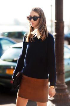 Navy sweater worn with a leather mini skirt