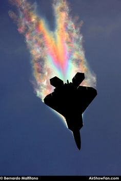 F-22 Raptor pulling so many Gs the low pressure air over the fuselage gets cold enough for the water to condense. The angle is just right for sunlight to make rainbow colors around the airplane (x-post /r/pics)