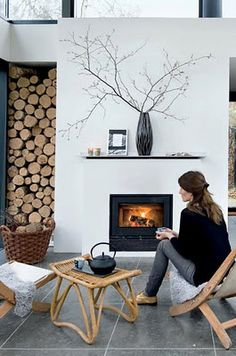 modern white fireplace, stacked wood as art