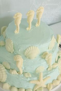 Pale aqua birthday cake with handmade white chocolate sea horse candles and shells Beach Themed Cakes, Beach Cakes, Seashell Cake, Seahorse Cake, Seahorses, Ocean Cakes, Homemade Birthday Cakes, Colorful Cakes, Fancy Cakes