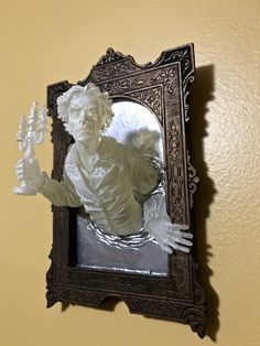 Inspired by Victorian horror literature, Michael Locascio created a set of sculptures showing ghosts emerging from a mirror. // spooky sculpture // contemporary Victorian art // contemporary Gothic art