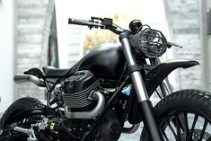 Miami-based Moto Studio created this stunning urban scrambler on Moto Guzzi's platform. Named Braapster, the build is minimal but mean, with all kinds of performance upgrades tucked into that spartan look. Moto Guzzi, Guzzi Bobber, Guzzi V9, Scrambler Motorcycle, Racing Motorcycles, Motorcycle Gear, Custom Motorcycles, Street Scrambler, Motorcycle Types