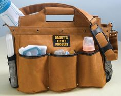 Designed to look like a tool bag that Daddy might use, this Builder Construction Daddy Diaper Bag is the perfect alternative for Dad to carry when caring for baby.  This diaper bag is ornamented with