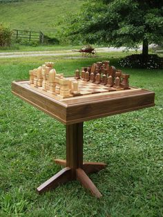 Hardwood Chess Table on etsy handmade  Maple and Walnut  chess pieces on solid Walnut  table, custom themed chess sets. $625.00, via Etsy.