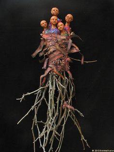 "Brenna Busse: Nature of Belonging  sticks, fabric, clay 38x28x6"" ©2007"