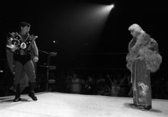 """Because a man dressed as a king can stare down a man dressed in a dressing gown and make it look AWESOME!    - Jerry """"The King"""" Lawler & Ric Flair"""