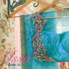 :Powder blue and sea green shaded net saree with patterned blouse and intricate hand embroidery.We can customize the colour size as per your requirement.To order please call/ WhatsApp on 9949944178 or mail us @ 09 December 2016 Half Saree Designs, Sari Blouse Designs, Saree Blouse Patterns, Fancy Blouse Designs, Bridal Blouse Designs, Model Workout Plan, Saree Designs Party Wear, Fancy Sarees Party Wear, Party Wear Sarees Online