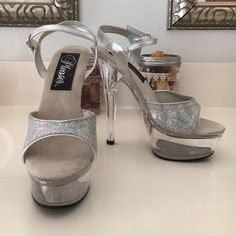 Sparkly Sexy Pleaser 6 inch clear platform Sultry and sweet.   Six inch heel with 1.5 inch platform.   Excellent condition. Missing some sparkles - unnoticeable when worn. Pleaser Shoes Platforms