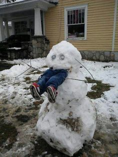 a child eating snowman