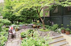 A dogwood shades the terrace of this Brooklyn home; the garden was created by Christina Michas Landscape Design.