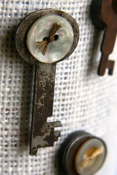 Glue a button on a rusty old key and turn it into a cute vintage magnet!