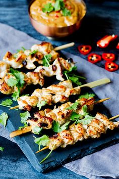 Easy chicken satay with peanut chilli sauce. Deliciously moist, marinated chicken served with a spicy peanut and coconut sauce.
