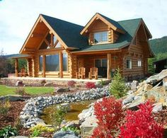 love the landscaping....the landscaping is nice, but I love the log house!