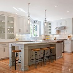 Kitchen Design, subway tile, large island with built in butcher block! Also love the lights above the island!