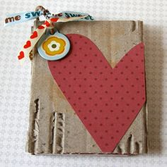 cute photo album using upcycled cardboard and scrapbook paper