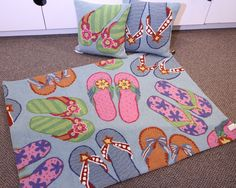 Precious assortment of flops make your entryway/kitchen/anywhere party-central! Wool Hook rug, spot clean or professional dry clean. Collection also includes two hook toss pillows, each sold separatel