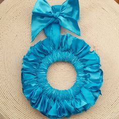 Check out this item in my Etsy shop https://www.etsy.com/listing/241184918/aqua-blue-frilly-ruffled-door-hanger
