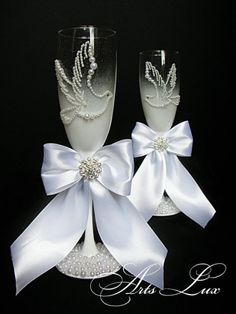 Two elegant hand decorated wedding champagne glasses