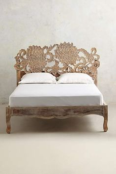 Handcarved Lotus Bed - anthropologie.com. Wood Statement Bed that looks Exotic